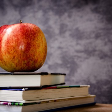 Apple and books - royalty free